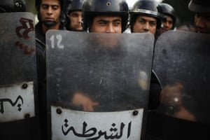 Tunisia uprising: Riot police stand ready during a demonstration in downtown Tunis