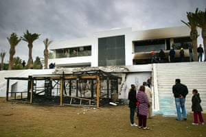 Tunisia uprising: People visit the burnt and looted house of Ben Ali's nephew