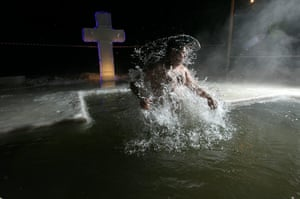 Orthodox epiphany: A Russian Orthodox believer jumps out of the icy water