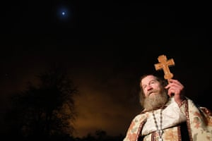 Orthodox epiphany: An Orthodox priest leads an Epiphany day celebration