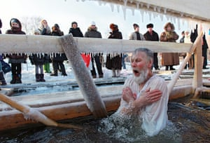 Orthodox epiphany: Russian man prays as he dives into the icy water of the Moskva River