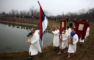 Orthodox epiphany: Believers hold a religious service, before swimming in Markovacko Lake