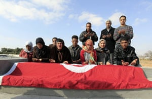 Tunisia uprising: The family of Mohamed Bouazizi pray and mourn at his grave in Sidi Bouzid