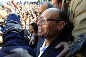 Tunisia uprising: Moncef Marzouki attends a protest in Sidi Bouzid