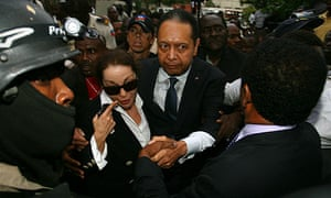 Jean-Claude 'Baby Doc' Duvalier and Veronique Roy leave court