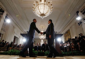 Hu Jintao in Washington: Barack Obama shakes hands with Hu Jintao after a joint news conference