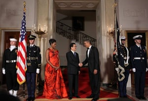 Hu Jintao in Washington: Barack Obama shakes hands with Hu Jintao as Michelle Obama looks on