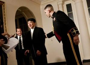 Hu Jintao in Washington: A Marine ushers action film star Jackie Chan through the White House