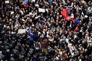 Tunisia protests: Protesters stand off against a line of riot police