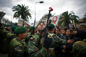 Tunisia protests: A soldier at Ben Ali's Constitutional Democratic Rally