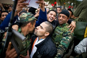 Tunisia protests: Protestors kiss soldiers during a demonstration