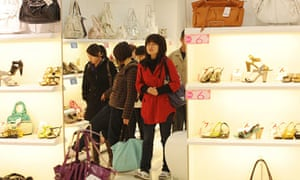 Chinese women shop for shoes at a mall i