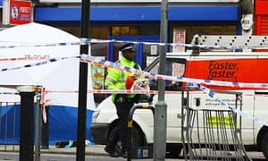 Police tape surrounds the scene of the fatal stabbing of a teenager in Tottenham, north London