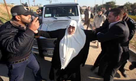 Protesters attempt to stop the French foreign minister Michele Alliot-Marie's car in Gaza
