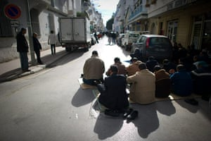 Tunisia: People pray on the streets in central Tunis on the national day of mourning