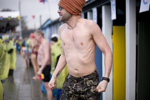 Cold water swimming: A competitor jumps up and down freezing cold after getting out of the pool