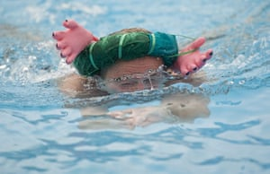 Cold water swimming: A swimmer in the Heads up breaststroke wearing an eccentric hat