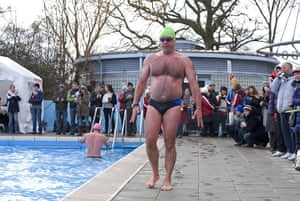 Cold water swimming: A swimmer emerges very red after taking part in the endurance race