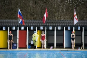 Cold water swimming: Three ladies and a marshall just before a race