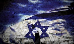An Israeli flag is projected on to the Old City walls of Jerusalem