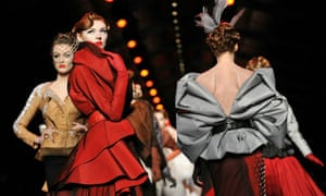 Models walk the runway during the Christian Dior show in Paris