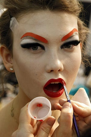 Paris Fashion Week: A model in make up before the show backstage