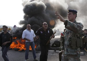 Lebanon Protests: A Lebanese Sunni Muslim supporter carries a stick