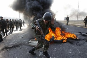 Lebanon Protests: Lebanese soldier runs past burning tires in Sidon