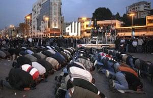 Lebanon Protests: Sunni supporters of Lebanese caretaker Prime Minister Saad Hariri pray