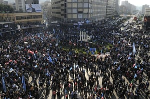 Lebanon Protests: Demonstrators carry flags during a protest