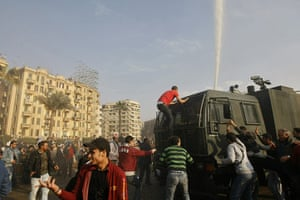 egpyt protests: Demonstrators surround a police water-cannon truck