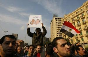 egpyt protests: Egyptian demonstrators hold up placards of Hosni Mubarak
