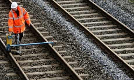 A Network Rail engineer checks tracks.
