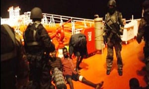 Malaysian navy commandos with Somali pirates they captured on the Malaysian tanker MT Bunga Laurel