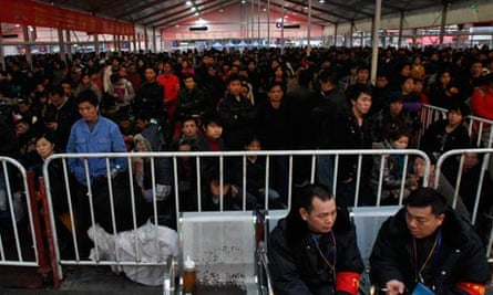 Thousands of passengers wait for trains and tickets at a railway station in Guangzhou