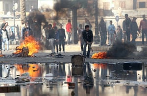 Egypt violence continues: Egyptian demonstrators burn tyres during demonstration in Suez