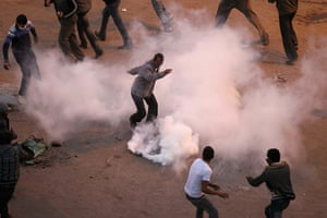 Egypt violence continues: Egyptian demonstrators try to remove a tear gas canister in Suez