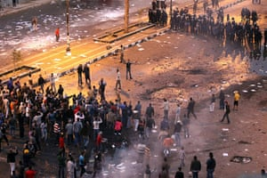 Egypt violence continues: Egyptian demonstrators stand opposite anti-riot police during clashes, Suez