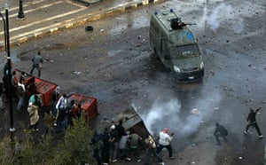 Egypt violence continues: Egyptian demonstrators battle a police van in Suez