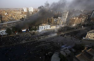 Egypt Protests: Smoke rises from a fire burning at the Suez fire station