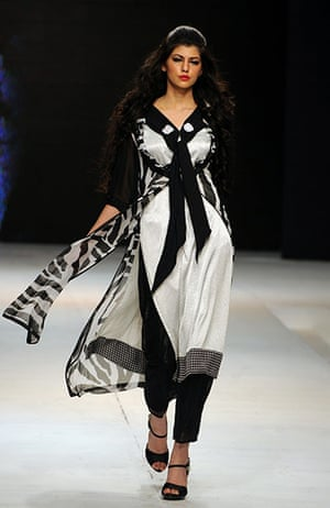 Islamabad Fashion Week: A Pakistani model displays a creation by Hameeda