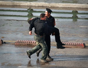Egypt protests Cairo: Police carry an injured colleague across the Kasr Al Nile Bridge, Cairo