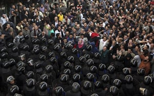 Protests in Egypt: Egyptian protesters face anti-riot policemen in Cairo