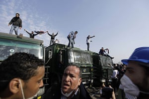 Protests in Egypt: Egyptian anti-government activists are seen atop police trucks