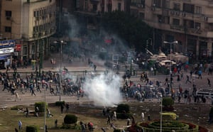 Egypt 29 January: Protestors flee a volley tear gas in Tarhir Square