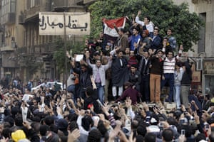 Egypt 29/01: Anti-government protesters on an Egyptian army armored personnel carrier
