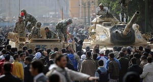 Egypt 29/01: A man shakes the hand of an Egyptian soldier on an armoured vehicle