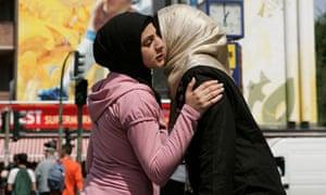 Two Muslim women greet each other in Berlin