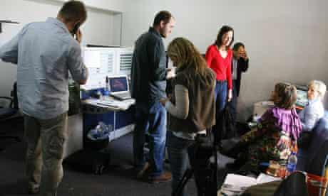 Al-Jazeera journalists gather at the channel's bureau in Cairo