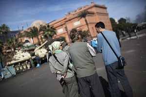 egypt protests continue: Foreign tourists stand outside the Egypt